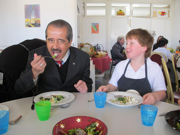 Mexican Minister sharing broccoli